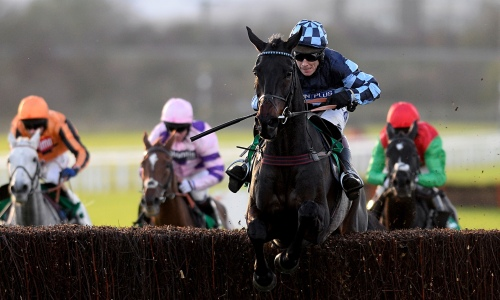 Richard Johnson and Menorah clear the last fence to win the Bet365 Charlie Hall Chase at Wetherby